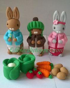 Totally edible set consists of all in the photo. Made from fondant icing, food colouring and edible glue. Veg etc also included. Please allow 7 days drying time for this item. May contain traces of nuts. Peter Rabbit Cake, Peter Rabbit Birthday, Fondant Icing Cakes, Fondant Cupcake Toppers, 4th Birthday Cakes, Birthday Cake Toppers, Fondant Birthday Cakes, Fondant Rabbit, Fondant Animals