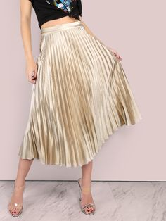 """Shake and twirl in these simply adorable bottoms. Featuring a midi lengthed skirt with pleated detailing, gorgeous metallic-y deep gold shine, a satin finish and a back zip closure. Skirt measures 32"""" in. from waist to bottom hem. Compliment with a beige crop top and gold jewels. Model is pictured in a size S. #gold #MakeMeChic #style #fashion #newarrivals #winter16"""