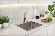 Contemporary white kitchen with Teka chrome faucet and steel single bowl sink. Visuals for product catalog.
