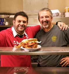 "Adam Richman, host of Travel Channel's ""Best Sandwich in America,"" and Andy Karandzieff of Crown Candy Kitchen in St. Louis with Crown Candy's BLT."