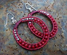 silver and red sparkly glass beads in 3 to 4mm sewn on soft red leather.