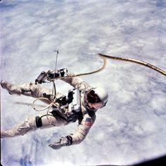 "Ed White was the first American to perform a space walk. Ed wears a pressure suit because there is virtually no air pressure at 200 miles altitude. The astronaut must also have an oxygen supply for breathing. One method is for the astronaut to remain connected to the spacecraft through an ""umbilical hose."" This hose supplies the astronaut with oxygen. This is the method which Ed White used when he became the first American astronaut to make a space walk in 1965.Photo courtesy of NASA."