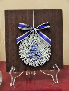 "Blue & Silver Ornament String Art- 7 1/4""x 7 7/8"" by StrungBySteel on Etsy https://www.etsy.com/listing/256055679/blue-silver-ornament-string-art-7-14x-7"