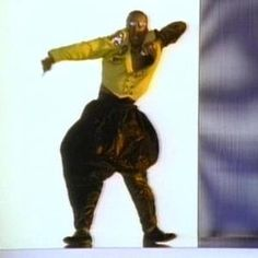 """MC Hammer - """"Can't touch this"""" at the height of his ridiculousness with those big pants"""