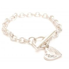 Heart Ten Tiny Toes Charm T-Bar Bracelet - A lovely memento of the birth of a child, a christening, a special birthday or as a way to keep a child no longer in your arms close to your heart. Whatever the reason, you are sure to treasure those innocent little hand or footprints forever.