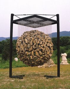 http://freshome.com/2012/06/11/manipulating-natural-materials-into-suspended-stone-installations/