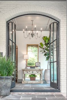steel french doors leading to gracious entry hall Design Entrée, House Design, Hall Design, Design Trends, Design Ideas, Foyer Design, Garden Design, Lobby Design, Design Inspiration