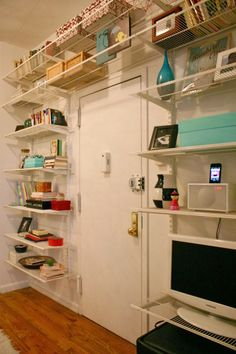 Hate the styling and cheap-looking shelves, BUT, this is a great way to use track-style shelving.  Try with a different style of shelves and LOTS of storage boxes.