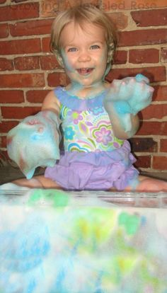 Giant sponge sensory play - super sudsy FUN with an easy to make homemade GIANT sponge.  This is a must try for those who love sensory play!