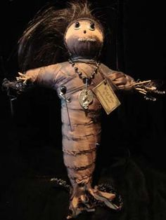 Voodoo Doll. They are easier than you would think. Sticks tied in a cross, wrapped with moss and then fabric, bits of the person who the doll is for (fingernails, hair, clothing, etc.... and a photo of the person) Sew it up and decorate.