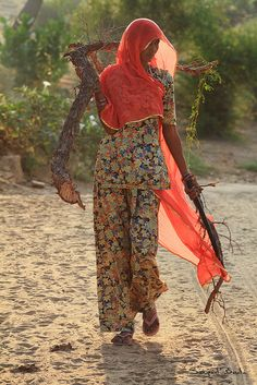 Walking passed a women collecting firewood for cooking at Gadisar Lake, Jailsalmer.