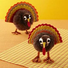 Thanksgiving Crafts: Set a pom pom turkey at each setting at the kids table.  They'll have a blast playing with the fuzz balls.