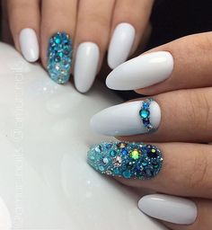If you are planning to visit a nice and warm place by the sea, choose this manicure. White and blue colors remind me on the sea waves.
