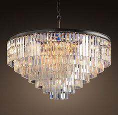"""Restoration Hardware - 1920s Odeon Glass Fringe 7-Ring Chandelier Iron $4995 The Art Deco style born in 1920s Paris is evident in the straight-and-curved lines of our elegant chandelier. Its optical-quality prisms, arranged in concentric rings, hang in sparkling counterpoint to an iron frame that bears the marks of the welder's torch.     Overall: 43½"""" diam., 34""""H     Chain: 24""""L     Weight: 291.9 lbs."""
