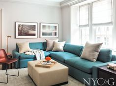 The library features a sofa covered in a Sahco fabric and Paul Kozal photographs. #NYC&G