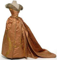 Evening dress, Worth, Paris, circa 1890  Shaped satin piping, metallic tulle, embroidery sequins and gold bullion
