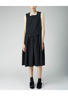 Jumper Dress by Comme Comme.  Oversized jumper dress featuring a belted front waist & a voluminous, pleated skirt.  Worn with / Maria La Rosa Mid-Calf Silk Socks & Simone Rocha Velvet Bow Loafer.