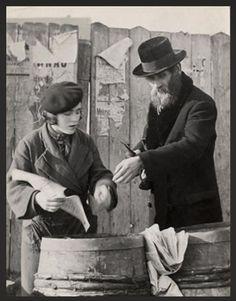 A man purchases herring for Shabbat in Mukacevo. (photo: Roman Vishniac)