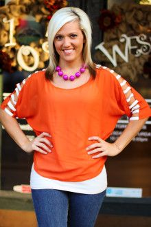 "In honor of the BIG WIN last night, we have our ""Krista"" Game Day Blouse on SALE!! Only a few left. S, M, L.  Regular $34.75, on SALE for $9.99. ~  105 West Boutique located in Abbeville, SC.  (864) 366-WEST.  Shipping $5.  Look for us on Facebook!"