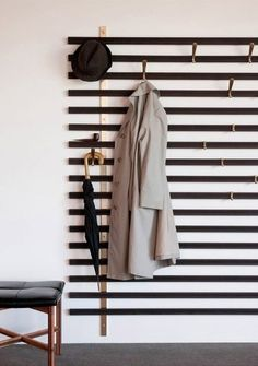 The Vestiaire Horizon is wall-mounted and consists of solid wedge slats, metal brass structures and metal hooks that can be positioned anywhere you'd like.