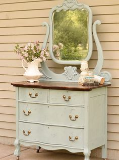 Dresser with serpentine drawers. Very pretty & I love the color and style!