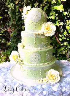 Wedding Cake Covered in light green fondant and sugarveil.