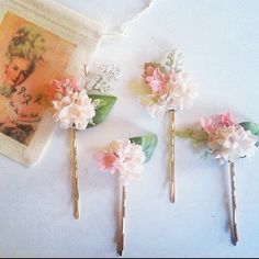 I have a ton of bobby pins with flowers & doodads...I never wear them though. But I always buy them. *lol*