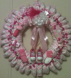 Baby Girl Diaper Wreath. I love this, its so original now that diaper cakes are all the rage!