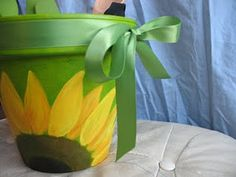 painted flower pot to hold kitchen utensils