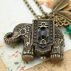 Vintage pocket watch necklace with antique bronze elephant pendant,lovely leaves charm and crystal charm. $3.99, via Etsy.