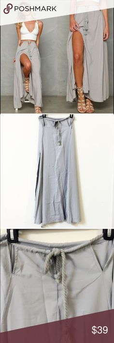 """Boho styled twisted rope slit skirt Super chic, due to fold, there are wrinkles. NWOT. Not see through or Not sheer. Color: bluish grey. Three small openings in the waist areas and twisted rope belt make the waist adjustable. Two front slits make the skirt very flowy and flirty. Size M waist can be adjusted to 34"""" length: 40.5"""". Size L waist can be adjust to around 35"""" length: 41.5"""", size XL waist can be adjusted to 36"""" length : 42.5"""" Skirts Maxi"""