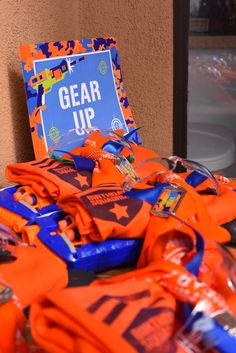 "Nerf war party gear: ""Birthday Squadron"" t-shirts, safety goggles, dog tags, orange bandanas and of course Nerf Guns!"