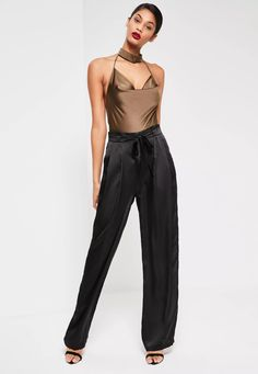 Ideal for work and play, these seriously silky trousers with a paperbag waist and in a chic wide leg style will update your wardrobe in just a few clicks.