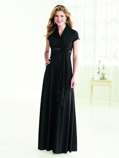 Classic styling and updated details combine to make this dress the most wearable of this performance season. Our new silky knit gathers to create a modest overlapping bodice with a high back shirred neckline. The satin empire band meets the gathers of the