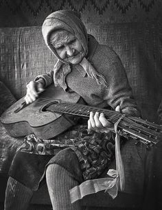♫♪ Music ♪♫ Old lady play guitar black & white photo