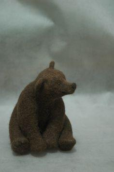 small felt bear sitting down