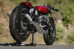 """'Sake' Yamaha RD400 – Lucky Custom. If motorcycles have earned the reputation as """"widow-makers"""" then two motorcycles in particular can lay claim to being the most lethal assassins. Both are '70s Japanese bikes from the golden age of two-strokes; the Kawasaki H2 750 is the Ivan Drago-style killer that will get right in your face and club you to death. But it's the Yamaha RD400..."""