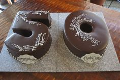 Chocolate number 50 shaped birthday cakes with fancy white scrolling