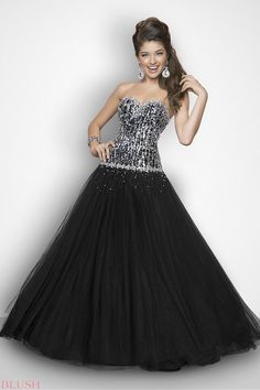 Sparkle in stones in a sexy prom dress! Dramatic mini crystals in black and silver drape your bodice as they flow vertically into a full tulle skirt. IN stock size 6