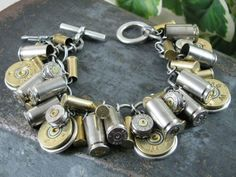 """""""Shotgun and Bullet Casing Jewelry - Mixed Nickel & Brass Bullet and Shotgun Casing Loaded Charm Bracelet"""" Etsy shop>>> thekeyofa THE KEY OF A, LLC - Upcycled Jewelry & Accessories Ammo Jewelry, Jewelry Crafts, Jewelry Box, Jewelry Bracelets, Jewelry Accessories, Jewelry Design, Jewelry Making, Geek Jewelry, Leather Bracelets"""