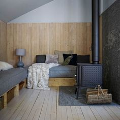 Discover small living room ideas on HOUSE - design, food and travel by House & Garden including this timber panelled chalet with a cosy wood-burning stove. Small Living Room Design, Living Room Seating, Small Living Rooms, Living Area, Swiss Chalet, Swiss Alps, Alpine Chalet, Timber Panelling, Wall Panelling