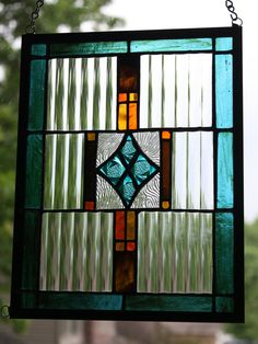 Turquoise, orange and brown stained glass panel