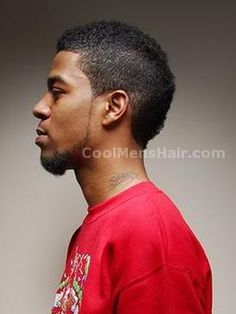 Image of Kid Cudi short curly mohawk hair for black men.