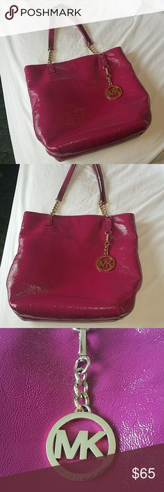 Michael kors bag Beautiful patent leather handbag in excellent used condition.  Fuschia color.  Magnetic snap closure on top.  Open pocket on back of bag.  Zip pocket inside along with 4 open pockets.  Inside has a minor stain.  This bag was carried for a month by a smoker.  I have been trying to air it out.  Priced accordingly.  Measures at 13x12 with strap drop at 12 inches MICHAEL Michael Kors Bags Shoulder Bags
