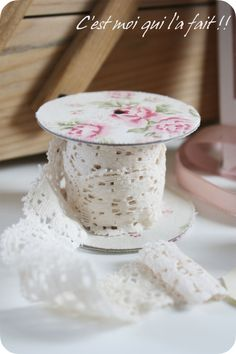 ~ great studio idea ~ paste pretty paper on ribbon spools,   make the spools from toilet paper rolls and cardboard