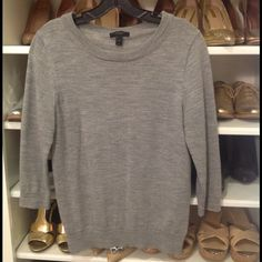 J.Crew gray merino Tippi sweater Basic sweater for work or play.  EUC, size medium a little shrunk after I hand washed in cold water.  If you think you are seeing double, you're right, I have two of these posted.  I have over 20 Tippi's in different colors for work.  Not sure how I ever got dressed without them. J. Crew Sweaters Crew & Scoop Necks