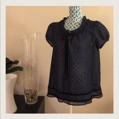 Baby doll top from Urban Outfitters Navy blue bow tie baby doll top.  Sheer material.  Velvet ribbon. Urban Outfitters Tops