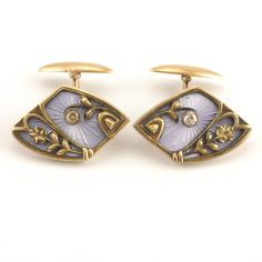 "8th Artel Enamel Diamond Gold Cufflinks. A pair of Russian 56 standard gold, guilloche enamel and diamond cufflinks, 8th Artel, Moscow, 1908-1917. Of diamond form, the cufflinks decorated with floral motifs set with a diamond against a translucent lavender enamel sunburst engine turned ground. Dimensions: 7/8"" x 5/8""."