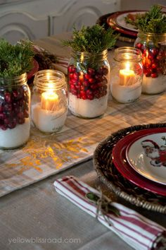 Would you believe that the snowy base of these mason jars is epsom salt? Layer in cranberries, sprigs of juniper and candles, of course, for a stunning display. Alternate candle-lit and juniper mason jars for added country flair. Click through for the tutorial and for more Christmas centerpieces sure to wow your guests this year.