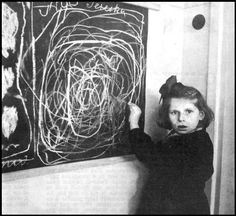 """A girl who grew up in a concentration camp draws a picture of """"Home"""" while living in a residence for disturbed children. Poland, 1948."""